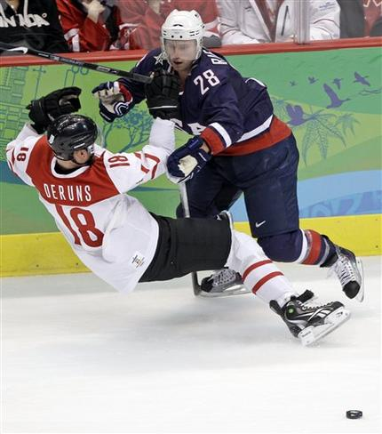 United States defenseman BRIAN RAFALSKI (28) of the Detroit Red Wings derails Switzerland forward THOMAS DERUNS (18) of HC Servette Geneva at the 2010 Winter Olympics. (Matt Slocum/AP)