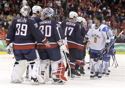 Finland assistant captain TEEMU SELANNE (8) leads his team through the hand-shake line with the United States after the Americans advanced to the Gold Medal Game with a surprising 6-1 result at the expense of Suomi. (Matt Slocum/AP)