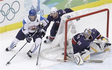 The Finnish Flash Selanne (8) is chased by United States defenseman RYAN SUTER (20) of the Nashville Predators as U.S. netminder RYAN MILLER (39) defends against the wrap-around. After taking a 6-0 lead, the United States had no urgent need to press the attack. Finland outshot the Americans 21-12 over the final two periods and finished even with the U.S. in that category for the game. (Chris O'Meara/AP)