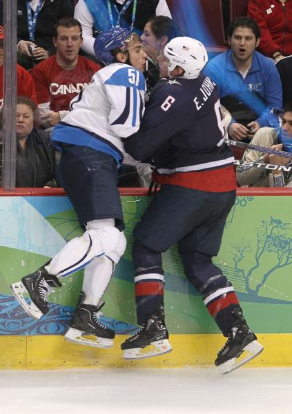 United States defenseman ERIK JOHNSON (6) of the St. Louis Blues and Finland forward VALTTERI FILPPULA (51) of the Detroit Red Wings meet face-to-face along the decorative boards in Vancouver. (Bruce Bennett/Getty Images)