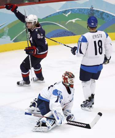 United States forward PATRICK KANE (88) welcomes Finnish goaltender NIKLAS BACKSTROM (33) to the semifinals of the 2010 Winter Games with a goal, his second of the match as Finland defenseman SAMI LEPISTO (18) of the Phoenix Coyotes looks away in Vancouver. (Shaun Best/Reuters)