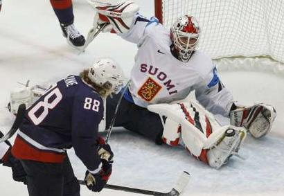 United States forward PATRICK KANE (88) backhands the black disc behind Finnish goalkeeper MIIKKA KIPRUSOFF for an astounding fourth American goal ten minutes and eight seconds into the Olympic semifinal match at the 2010 Vancouver Games. (Todd Korol/Reuters)