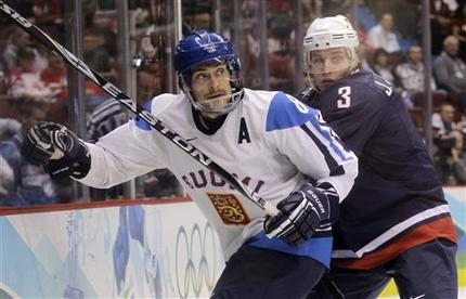 After the six-goal onslaught, all that was left to do for the United States was play sound, defense-first hockey. Here, Finland's all-time leader with 50 goals at major international tournaments, TEEMU SELANNE (8) of the Anaheim Ducks, is checked by his southern California NHL rival of the Los Angeles Kings, American defenseman JACK JOHNSON (3). Selanne was held off the scoresheet by the U.S. and remained goal-less at the 2010 Winter Games in Vancouver. (Matt Slocum/AP)