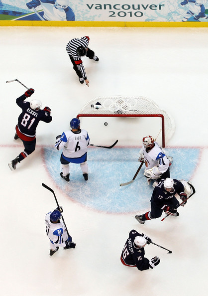 One former University of Minnesota player, U.S. forward PHIL KESSEL (81), celebrates the goal of another, the not-picutred St. Louis Blues defenseman ERIK JOHNSON as Finnish defenseman SAMI SALO (6) stands stunned in the goal crease. Malone (12) and Pavelski (16) prepare to revel for the Americans while VALTTERI FILPPULA (51) is left to reflect for Finland. (Cameron Spencer/Getty Images)