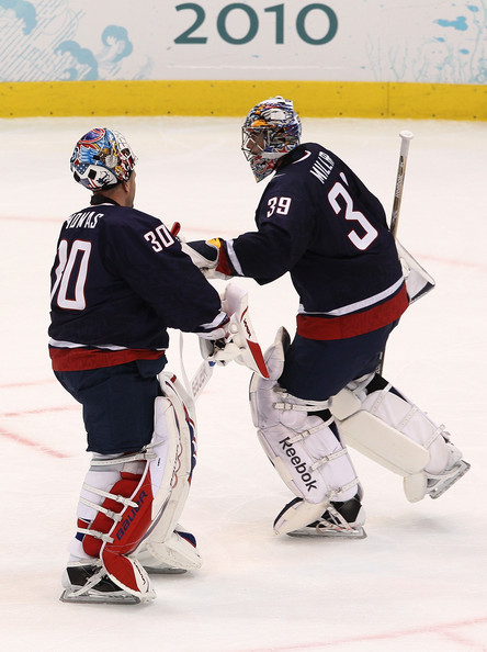 United States goaltender RYAN MILLER (39) of the Buffalo Sabres is replaced at 8:29 of the third period by TIM THOMAS (30) of the Boston Bruins with Americans still leading 6-0 in the Olympic semifinals at Canada Hockey Place. Up to this point, Miller has played every minute of every U.S. match at the 2010 Vancouver Games. Thomas, 35, is a veteran of four seasons in the Finnish elite league for the IFK Helsinki, Karpat Oulu and Jokerit Helsinki clubs. (Bruce Bennett/Getty Images)