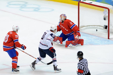 Former University of Minnesota star PHIL KESSEL shoots past Norwegian goaltender PAL GROTNES as defenseman MATS TRYGG despairs the early 1-0 American lead. The United States comfortably defeated Norway 6-1 to remain unbeaten at the 2010 Winter Olympics in Vancouver. Kessel registered a goal and an assist in the match. (Matthew Manor/HHOF-IIHF Images)