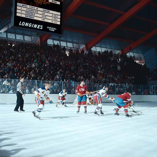 CZECHOSLOVAKIA (red shirts, blue pants) face-off against the UNITED STATES (white shirts, red pants) on the final day of competition at the 1960 Winter Olympic Games at Squaw Valley.