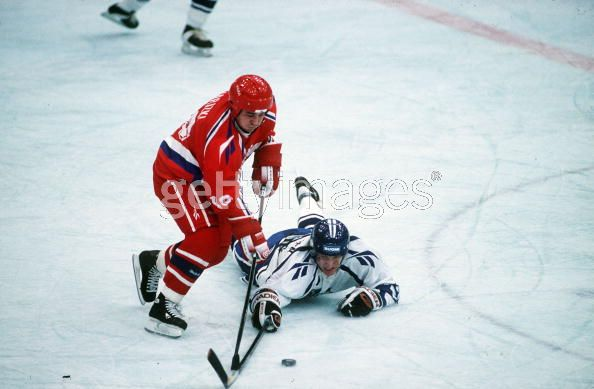 A Finnish player lunges in a bid to steal the puck from the on-rushing Russian player in a historic match at the 1994 Winter Olympic Games in Lillehammer, Norway. In just their second-ever Olympic match, the Russians managed to 'accomplish' what had never been 'achieved' before by the old juggernaut from the Soviet Union.