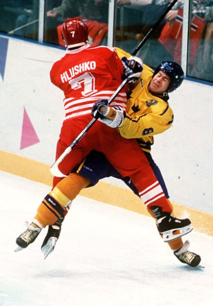 Canada left wing TODD HLUSHKO (7) hits Sweden defenseman MAGNUS SVENSSON (8) head-on in the Gold Medal Match at the 1994 Winter Olympic Games in Lillehammer, Norway.