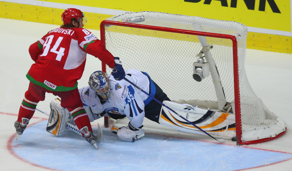 MIKHAIL GRABOVSKI of Belarus pushes the puck past Finland's PEKKA RINNE (35) in a shootout at the 2009 IIHF World Championships in Zurich, Switzerland. Belarus upended Finland 2-1 in sudden-death. Grabovski of the Toronto Maple Leafs, who fractured his wrist shortly after the New Year, was withdrawn from the Belarus Olympic team for the 2010 Vancouver Games.
