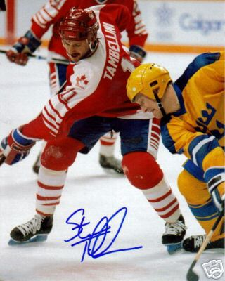 Stanley Cup winner STEVE TAMBELLINI takes on a Swede at the 1988 Winter Olympic Games in Calgary, Canada. Tambellini was a member of the New York Islanders first Stanley Cup champion in 1980. The 29-year-old Vancouver Canucks center totaled one goal and three assists for Canada at the Calgary Games.