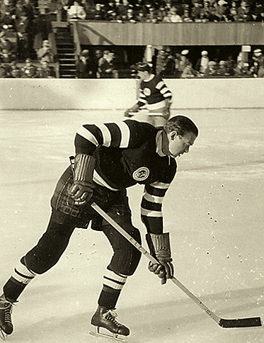 All-time German great GUSTAV JAENECKE stickhandling here for powerhouse German outfit Schlittschuhclub Berlin. Jaenecke first skated with the national team as an 18-year-old in 1927 and finished in 1939 after scoring 43 goals (82 games) for Germany in all competitions. A powerful left wing, Jaenecke also spent time on defense in the latter years of his career.