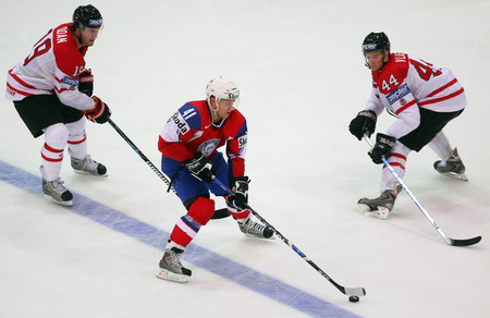Norway's PATRICK THORESEN (41) is confronted by two Canadians at the 2009 IIHF World Championships in Zurich, Switzerland. Thoresen, a one-time Edmonton Oiler and Philadelphia Flyer, is currently 7th in scoring for Russian club Salavat Yulayev Ufa (53 ga, 21 go 31 as, 52 pts) in the Kontinental Hockey League.