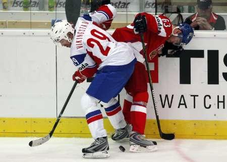 Norway's TORE VIKINGSTAD (29) competes for the puck at his feet with a challenger from the Czech Republic. It was Vikingstad who scored the most important goal in Norwegian hockey history to date --- the game-winner in Norway's 4-3 upset of Canada at the 2000 IIHF World Championships in St. Petersburg, Russia.