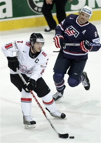 Switzerland captain MARK STREIT of the New York Islanders controls the puck versus the United States at the 2009 IIHF World Championships in Bern. Switzerland defeated the United States 4-3 in the match. Streit, 33, will be a pivotal player for the Swiss in Vancouver.