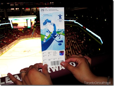 "The ""Toronto Girl Out West"" holds up her ticket to the Finland-United States semifinal match for the 2010 Winter Olympic Games at Canada Hockey Place in Vancouver. (TorontoGirloutWest photo)"
