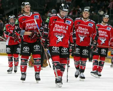 The KOELNER HAIE (Cologne Sharks) have fallen on hard financial times in the Deutsche Eishockey Liga. The number of immediate on-ice victories for Cologne could very well decide the future economic viability of the club.
