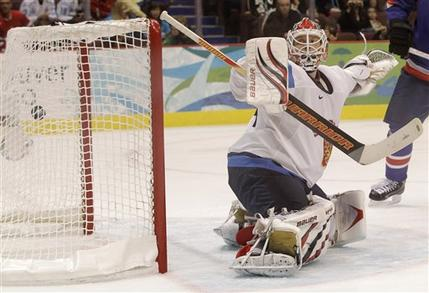 The wrist shot of the not-pictured MARIAN GABORIK of Slovakia escapes Finnish netminder MIIKKA KIPRUSOFF and bulges the back of the net in the Bronze Medal Match at Canada Hockey Place. (Julie Jacobson/AP)