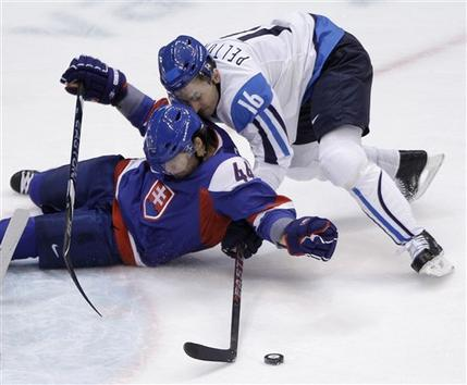 Slovakia defenseman ANDREJ SEKERA (44) of the Buffalo Sabres and Finland forward VILLE PELTONEN (16) of Belarussian club Dynamo Minsk in the Kontinental Hockey League hit the deck in the Bronze Medal Match in Vancouver. Peltonen, 36, a four-time Olympian who played for the San Jose Sharks, Nashville Predators and Florida Panthers in the NHL, was appearing in his 144th game for Finland at a major international tournament. (Matt Slocum/AP)
