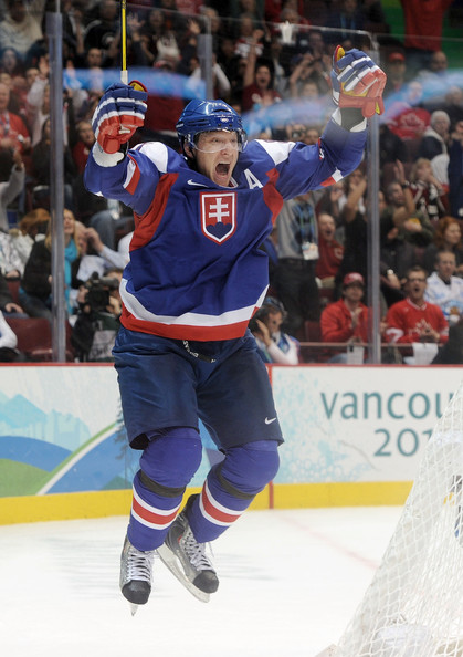 The Slovak assistant captain MARIAN HOSSA jumps for joy after sending Slovakia to the lead in the Bronze Medal Match at the 2010 Vancouver Games. Hossa now stands alone in second place on Slovakia's all-time scoring chart for major international tournaments with 65 points. (Harry How/Getty Images)