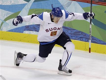 OLLI JOKINEN (12) rejoices as his second goal of the game has given Finland a 4-3 lead over Slovakia in the Bronze Medal Match at Vancouver. For the 31-year-old, his 32nd goal at a major international event ties the three-time Olympian for fifth place with MIKA NIEMINEN on Finland's all-time goal-scoring chart. (Matt Slocum/AP)