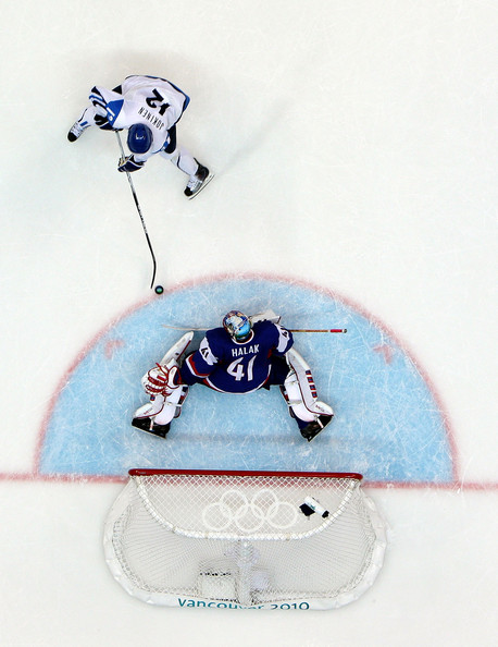 After receiving the pinpoint pass from defenseman JONI PITKANEN, Finland forward OLLI JOKINEN (12) confronts Slovakia goaltender JAROSLAV HALAK unhindered in the Bronze Medal Match of the 2010 Winter Olympics in Vancouver. (Bruce Bennett/Getty Images)