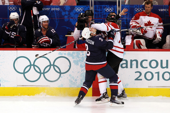 Canada were never prepared to have the United States push them around on home ice in the Gold Medal Game from Vancouver. Here, Canada's DANY HEATLEY (15) delivers a forearm to the face of United States defenseman JACK JOHNSON (3) of the Los Angeles Kings at Canada Hockey Place. (Jamie Squire/Getty Images)