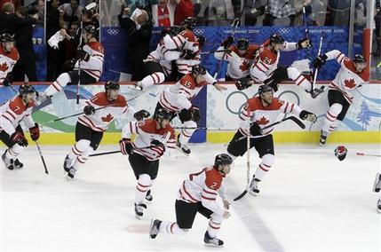 The victorious bench clears moments after SIDNEY CROSBY's overtime goal gives Canada a dramatic 3-2 decision over the United States in the Gold Medal Game of the ice hockey tournament at the 2010 Winter Olympics from Vancouver, Canada. (Julie Jacobson/AP)