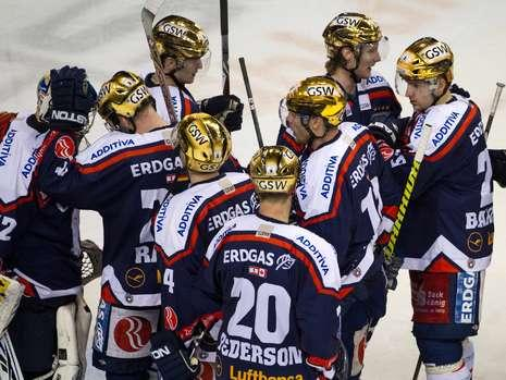 ANDRE RANKEL butts heads with Eisbaeren Berlin's heroic goaltender, ROB ZEPP, at the conclusion of the Deutsche Eishockey Liga quarterfinal match versus Augsburg Panthers at the O2 World Arena. In the foreground is Eisbaeren's retiring veteran, DENIS PEDERSON (20), who has bagged four German championships in Berlin. (Bild.de photo) 
