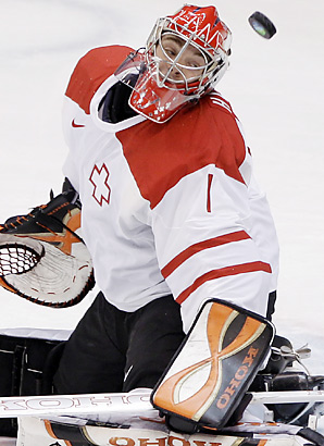Swiss goaltender JONAS HILLER (1) will not be holding the fort for his country in Germany this spring. (AP photo)