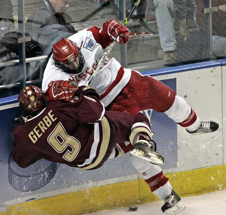 University of Wisconsin rearguard JEFF LIKENS rams Boston College forward NATHAN GERBE (9) along the boards at the Bradley Center in the 2006 NCAA men's ice hockey championship game. (Jeffrey Phelps/AP)