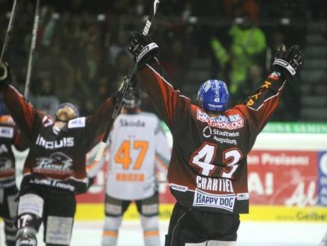 Canadian defenseman CHRISTIAN CHARTIER (43) and American forward CHRIS COLLINS (17) exalt after Chartier's late third period power play goal in the DEL semifinals at the Curt Frenzel Stadion in Bavaria. (volksfreund.de photo)