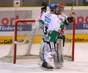Augsburg's German goalie DENNIS ENDRAS is greeted by Canadian defenseman CHRISTIAN CHARTIER (43) in front of the Panthers net. Endras saved 53 shots in Augsburg's rubber-match defeat of Eisbaeren Berlin. (Christof Koepsel/Bongarts/Getty Images)