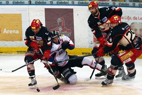 Three Hannover Scorpions surround an ERC Ingolstadt skater in Game Three of the Deutsche Eishockey Liga semifinals from TUI Arena in Lower Saxony. Hannover reached the DEL finals for the first time in club history with a three games-to-none series sweep of ERC Ingolstadt. (Bongarts/Getty Images)