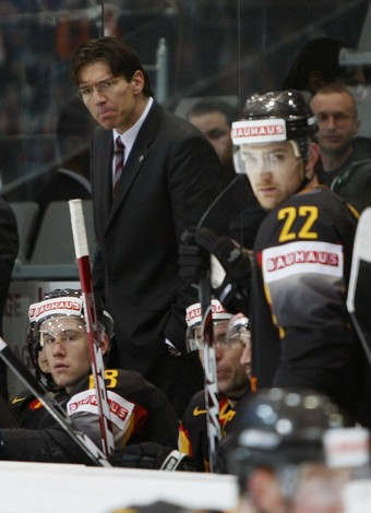 National team coach UWE KRUPP fashions a frown face during Germany's 3-1 loss to Denmark at the 2009 IIHF World Championships in Bern, Switzerland. (Petr Josek/Reuters)