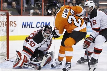 Philadelphia Flyers forward VILLE LEINO (22) of Finland sees his shot blocked by the New Jersey Devils' Canadian Olympic goaltender MARTIN BRODEUR (30) at the Wachovia Center on South Broad Street in late March. (Matt Slocum/AP)